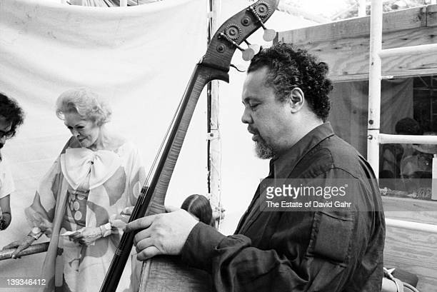 Jazz bassist and composer Charles Mingus and actress Fran Allison backstage at the Newport Jazz Festival New York at Wollman Auditorium in Central...