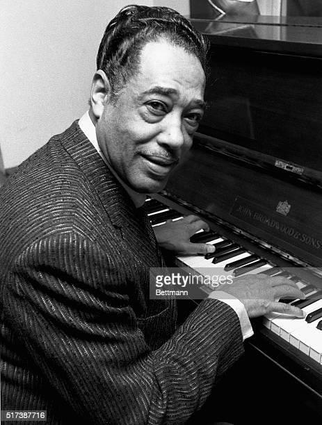 Jazz great Duke Ellington sits at the piano