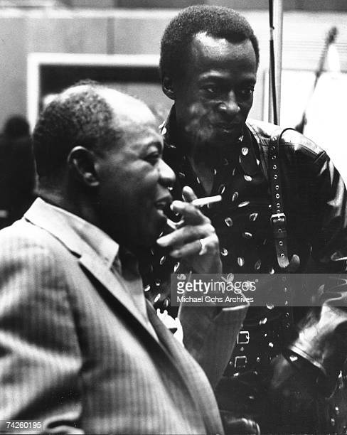 Jazz greats Miles Davis and Louis Armstrong talk in the studio in circa 1965