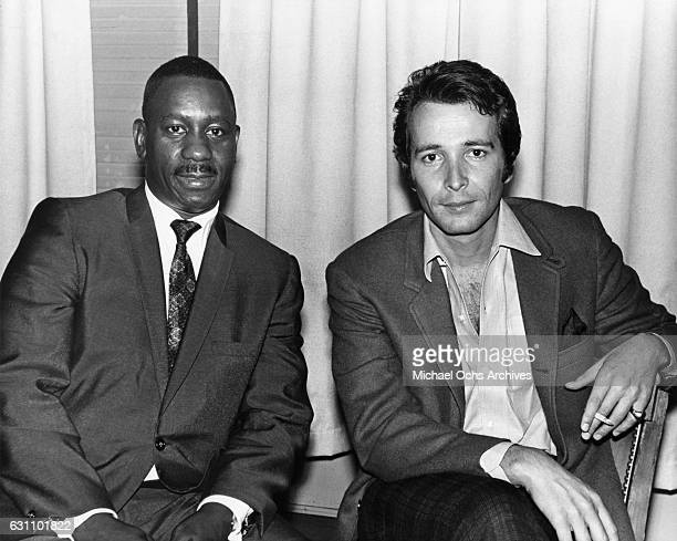 Jazz guitarist Wes Montgomery and Herb Alpert pose for an AM Records publicty still in September 1967