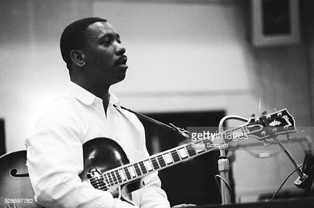 Jazz guitarist Wes Montgomery during a recording session at Plaza Sound Studios in New York City