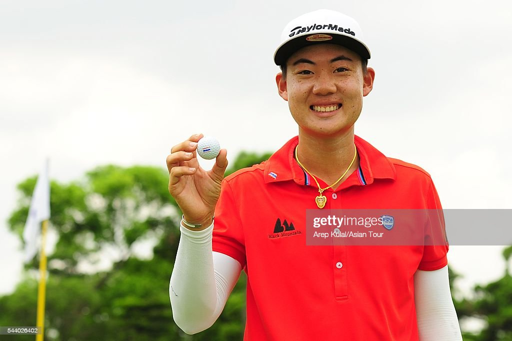 Jazz Janewattananond of Thailand poses with his golf ball after making the hole-in-one during the round 2 of the Yeangder Tournament Players Championship 2016 at Linkou International Golf Club on July 1, 2016 in Taipei, Taiwan.