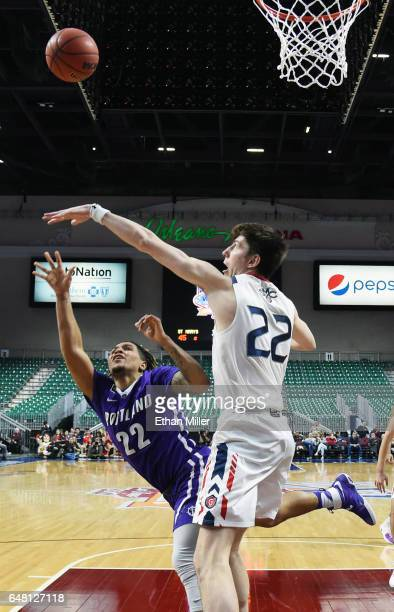 Jazz Johnson of the Portland Pilots shoots against Dane Pineau of the Saint Mary's Gaels during a quarterfinal game of the West Coast Conference...