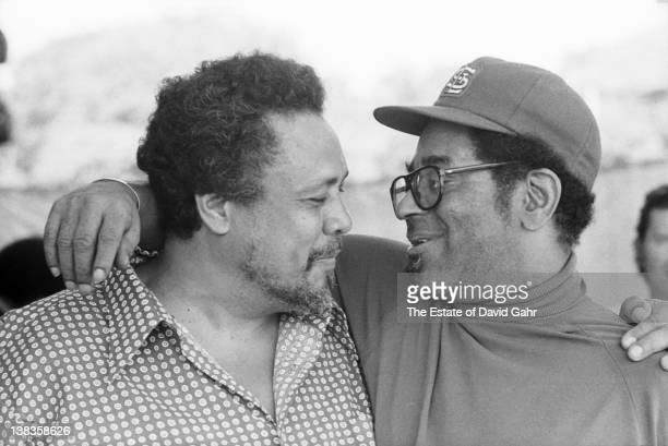 Jazz legends Dizzy Gillespie and Charles Mingus backstage in July 1971 at the 1971 Newport Jazz Festival in Newport Rhode Island
