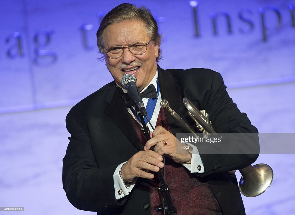 Jazz musician Arturo Sandoval performs during a dinner for Medal of Freedom awardees at the Smithsonian National Museum of American History on November 20, 2013 in Washington, DC. The Presidential Medal of Freedom is the nation's highest civilian honor, presented to individuals who have made meritorious contributions to the security or national interests of the United States, to world peace, or to cultural or other significant public or private endeavors.