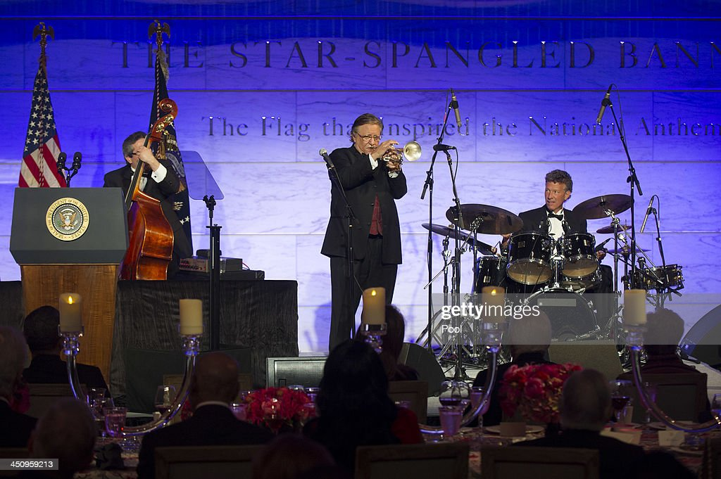 Jazz musician <a gi-track='captionPersonalityLinkClicked' href=/galleries/search?phrase=Arturo+Sandoval+-+Musician&family=editorial&specificpeople=228099 ng-click='$event.stopPropagation()'>Arturo Sandoval</a> performs during a dinner for Medal of Freedom awardees at the Smithsonian National Museum of American History on November 20, 2013 in Washington, DC. The Presidential Medal of Freedom is the nation's highest civilian honor, presented to individuals who have made meritorious contributions to the security or national interests of the United States, to world peace, or to cultural or other significant public or private endeavors.
