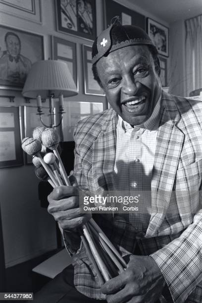 Jazz musician Lionel Hampton holds a handful of Vibraphone sticks