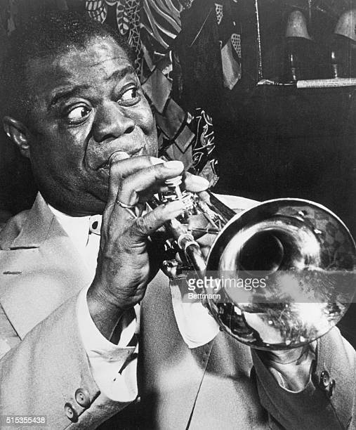 Jazz musician Louis Armstrong performs during one of his personal appearances in Baltimore Undated photograph