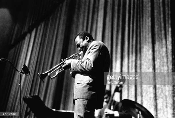 Jazz musician Miles Davis and Paul Chambers performs onstage at the Apollo Theatre in 1960 in New York