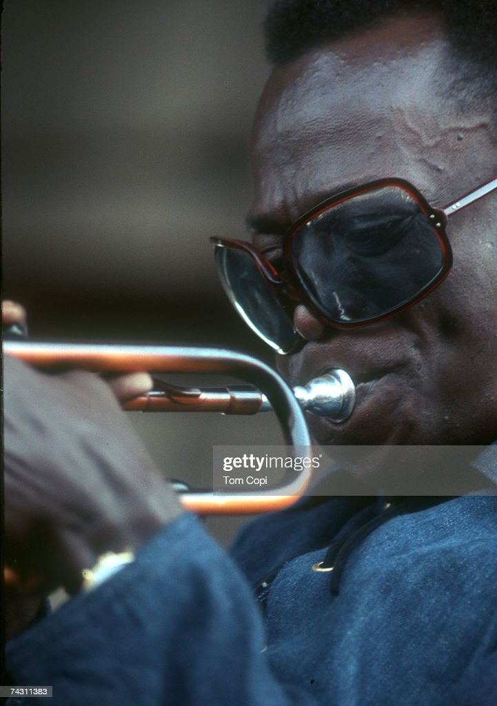 Jazz musician Miles Davis plays his trumpet at the Newport Jazz Festival in 1969 in Newport, Rhode Island.
