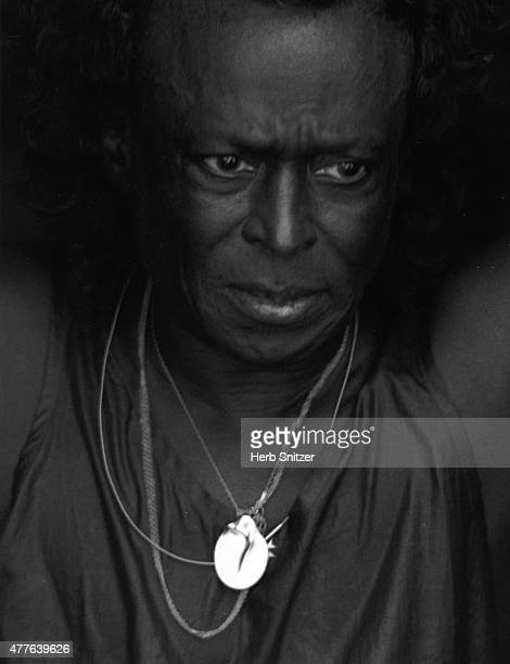 Jazz musician Miles Davis poses for a portrait session at Newport Jazz Festival in 1980 in Newport RI