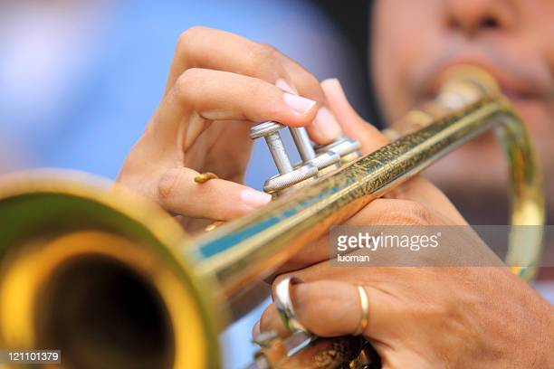 Jazz musician playing a trumpet