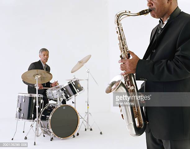 Jazz musicians playing saxophone and drums