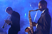Jazz Musicians Playing Saxophone and Trumpet in a Nightclub