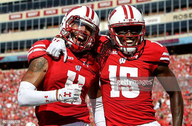 Jazz Peavy and Robert Wheelwright of the Wisconsin Badgers celebrate after Peavy scored a touchdown in the second quarter against the Akron Zips at...