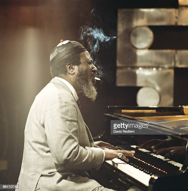 Jazz pianist Thelonious Monk performs smoking a cigarette while playing the piano on the Jazz Scene TV show filmed at Ronnie Scott's Club on April...