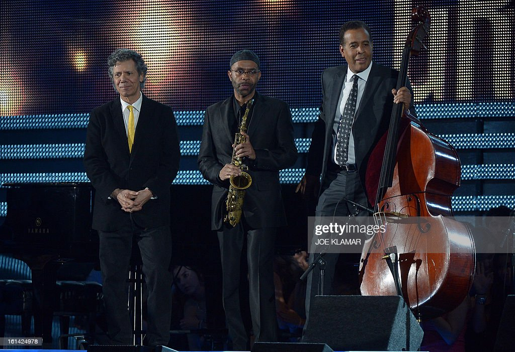 Jazz piano player Chick Corea, saxophonist Kenny Garrett and bassist Stanley Clark stand on stage at the Staples Center during the 55th Grammy Awards in Los Angeles, California, February 10, 2013. AFP PHOTO Joe KLAMAR