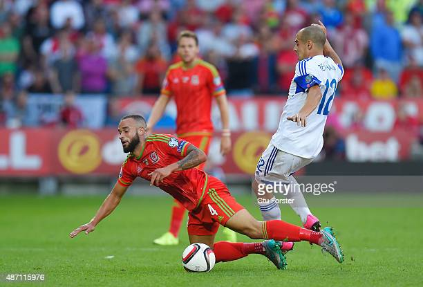 Jazz Richards of Wales is fouled by Tal Ben Haim of Israel during the UEFA EURO 2016 group B qualifying match between Wales and Israel at Cardiff...