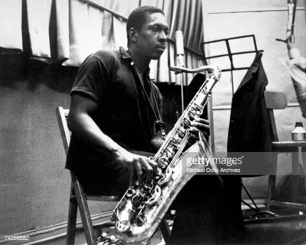 Jazz saxophonist John Coltrane records in the studio in circa 1958