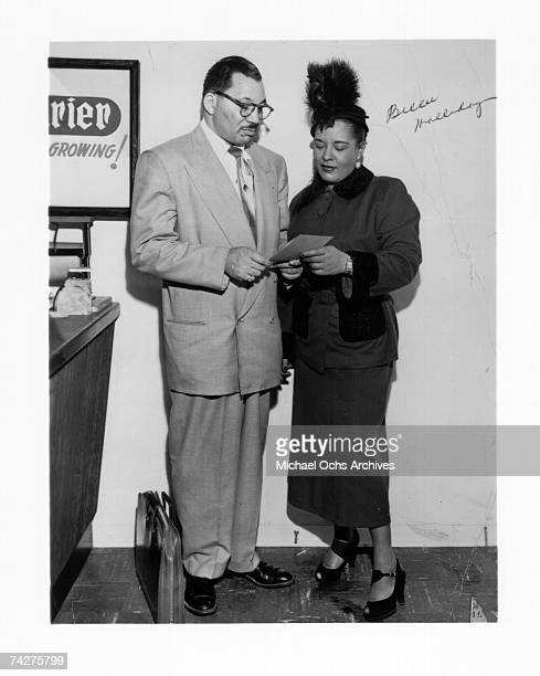 Jazz singer Billie Holiday chats with attorney Walter L Gordon Jr circa 1946 in Los Angeles California