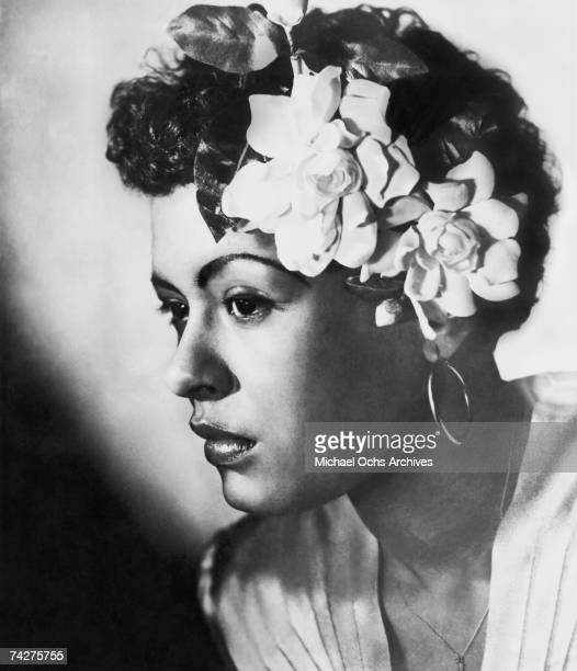 Jazz singer Billie Holiday poses for a portrait in circa 1939 with a flower in her hair