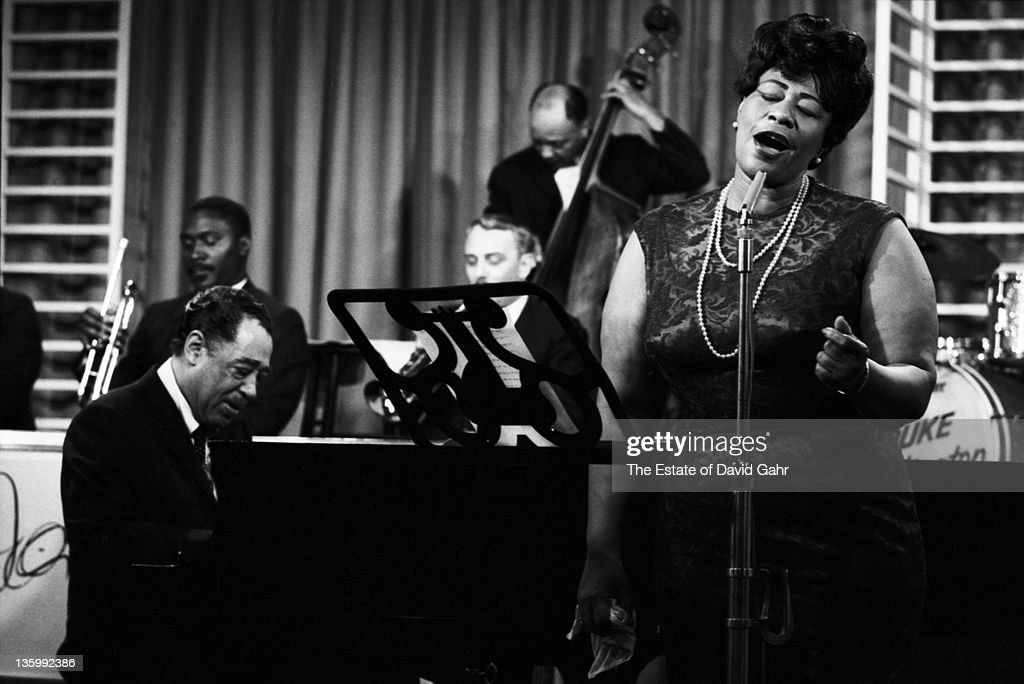 Jazz singer <a gi-track='captionPersonalityLinkClicked' href=/galleries/search?phrase=Ella+Fitzgerald&family=editorial&specificpeople=90780 ng-click='$event.stopPropagation()'>Ella Fitzgerald</a> performs with Duke Ellington at NBC-TV Studios in May 1964 in New York City, New York.