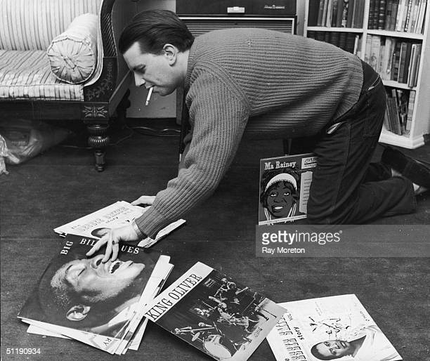 Jazz singer George Melly organises his record collection at his Chelsea home April 1960