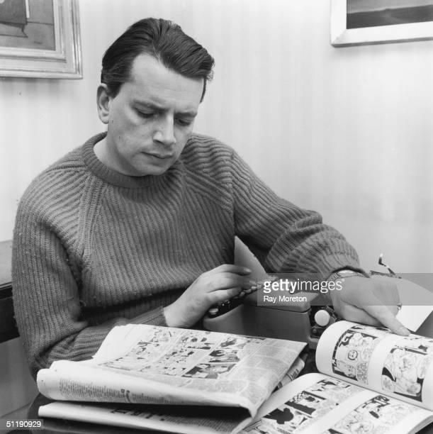 Jazz singer George Melly relaxes at his Chelsea home with a comic strip April 1960