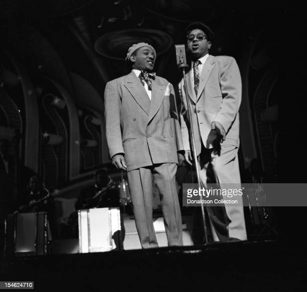 Jazz singer Joe Carroll performs a duet with Dizzy Gillespie and his BeBop Orchestra at the Strand Theater on Broadway on December 10 1948 in New...