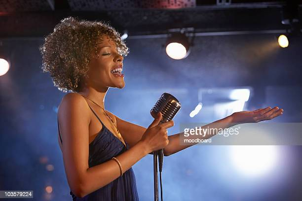 Jazz singer on stage, side view