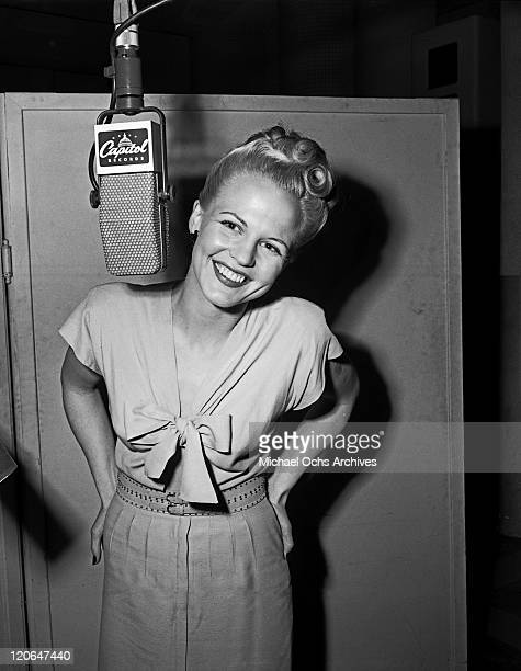 Jazz singer Peggy Lee records in the Capitol Records studios on April 10 1946 in Los Angeles California