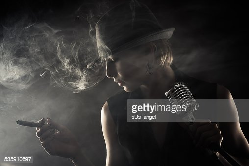 jazz singer with cigar and microphone : Stock Photo