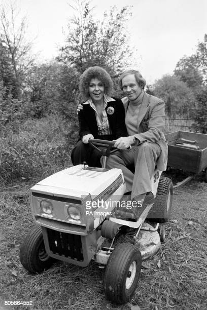Jazz singers and husband and wife team Cleo Laine and John Dankworth at the wheel of their motorised lawn mower