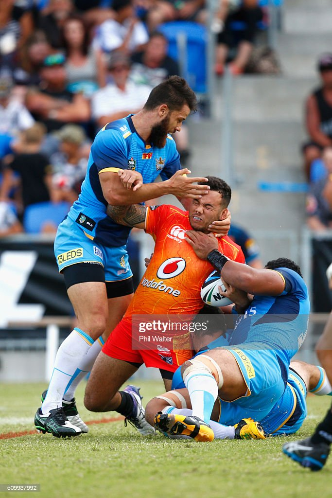 Jazz Tevaga of the Warriors is tackled to the ground during the NRL Trial Match between the New Zealand Warriors and the GOld Coast Titans at Toll Stadium on February 13, 2016 in Whangarei, New Zealand.