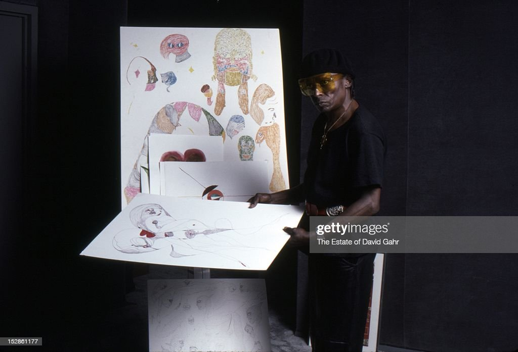 Jazz trumpeter and composer Miles Davis poses for a portrait at home with an easel and several samples of Davis' paintings, a passionate hobby for the artist when not composing, recording, or performing, on April 15, 1984 in New York City, New York.