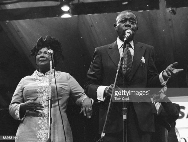 Jazz trumpeter Louis Armstrong performs with Gospel singer Mahalia Jackson at the Newport Jazz Festival in 1970 at Festival Field in Newport Rhode...