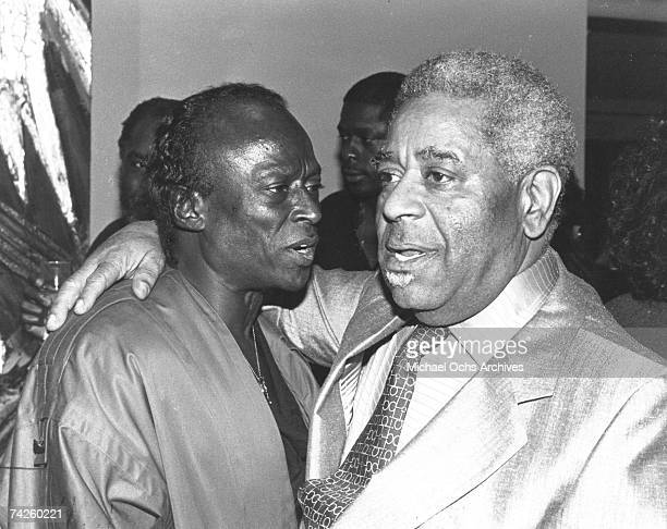 Jazz trumpeter Miles Davis chats with fellow jazz legend Dizzy Gillespie at Miles' birthday party on May 26 1984