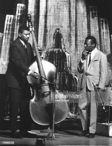 Jazz trumpeter Miles Davis performs onstage at the Apollo Theater with his bass player Paul Chambers in 1960 in New York City New York