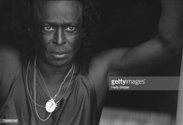 Jazz trumpeter Miles Davis performs onstage at the Newport Jazz Festival in 1990 in Newport Rhode Island