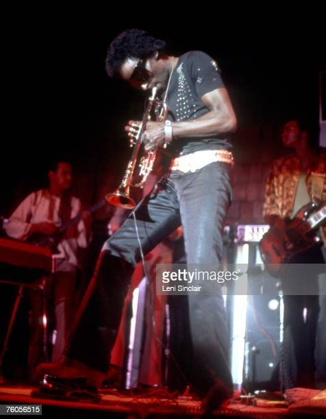 Jazz trumpeter Miles Davis performs onstage in circa 1972