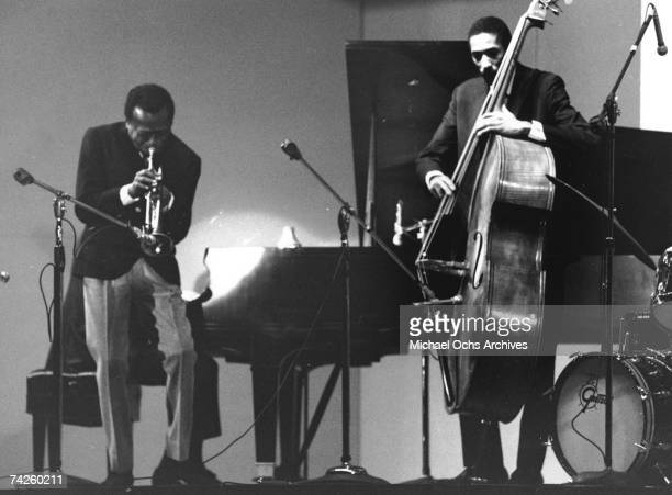 Jazz trumpeter Miles Davis performs onstage with his horn in circa 1965