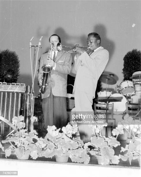 Jazz trumpeter Miles Davis performs onstage with saxophonist Lester Young in circa 1955