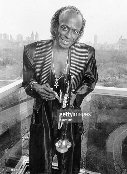 Jazz trumpeter Miles Davis stands on the balcony of his apartment overlooking Central Park