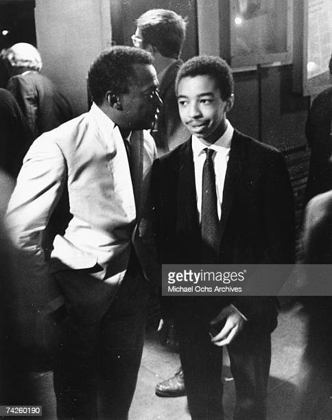 Jazz trumpeter Miles Davis talks with his 17 year old drummer phenom Tony Williams during a break in their performance at the Jazz Workshop in 1963...