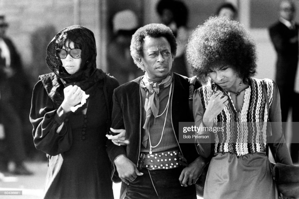 Jazz trumpeter Miles Davis w. his singer wife Betty Mabry (L) & an unident. woman arriving at the funeral of rock guitarist Jimi Hendrix.