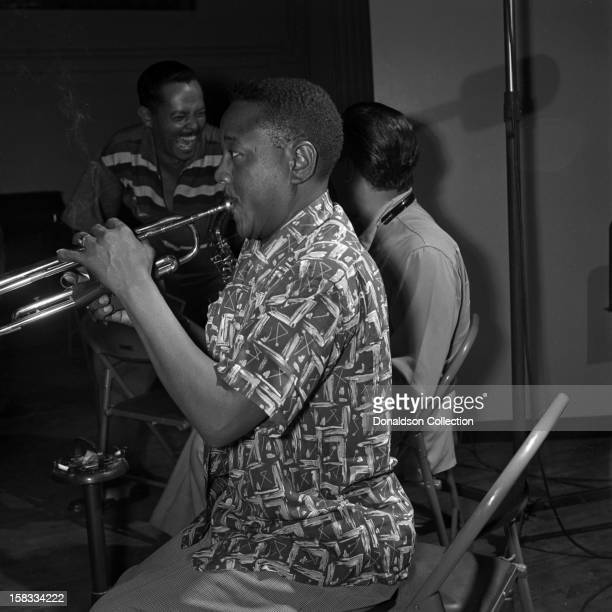 Jazz trumpeter Roy 'Little Jazz' Eldridge records with the 1953 metronome All Stars as singer Billy Eckstine laughs with saxophonist Lester Young at...