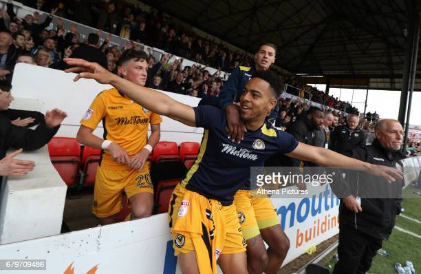 Jazzi BarnumBobb of Newport County celebrates after the final whistle as a late goal from Mark O'Brien secures safety for Newport to stay in League...