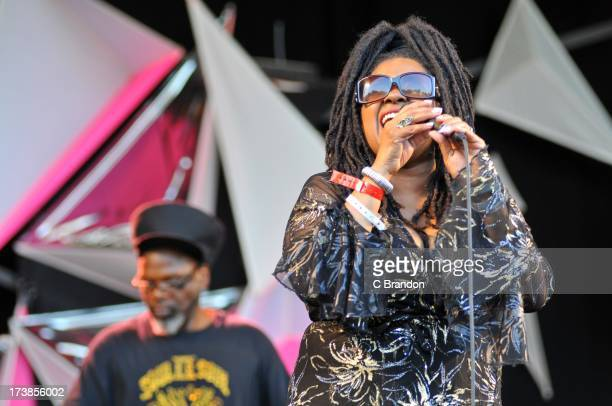 Jazzie B and Caron Wheeler of Soul II Soul perform on stage at Kew Gardens on July 13 2013 in London England