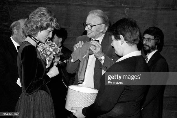 Jazzman Humphrey Lyttelton shows the Princess of Wales tshirts for her son's Princes William and Harry presented to her at the London Palladium by a...
