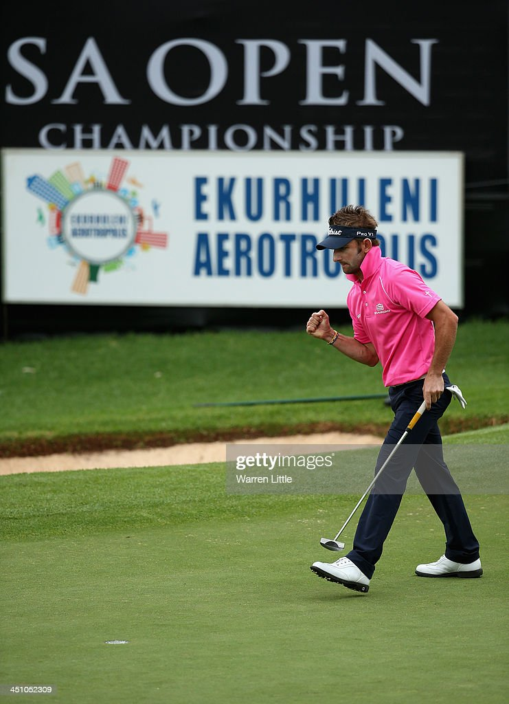 Jbe Kruger of South Africa celebrates a par on the 18th green during the first round of the South African Open Championship at Glendower Golf Club on November 21, 2013 in Johannesburg, South Africa.